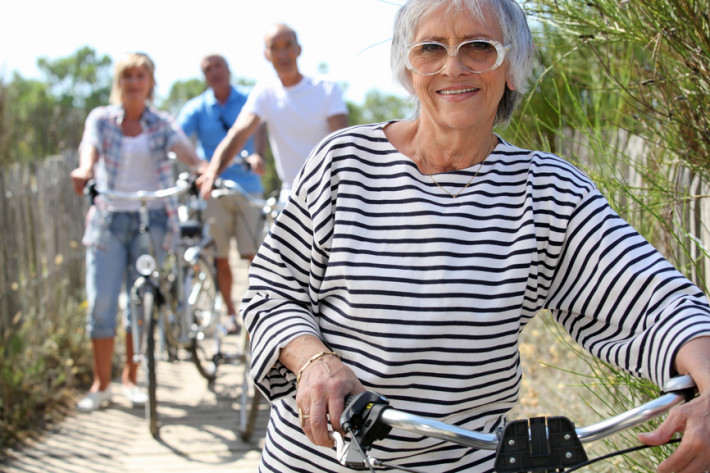 Older woman and friends on a bike ride